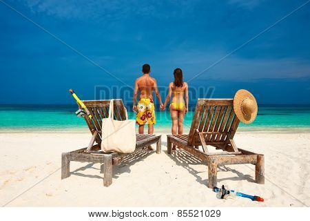 Couple in yellow on a tropical beach at Maldives
