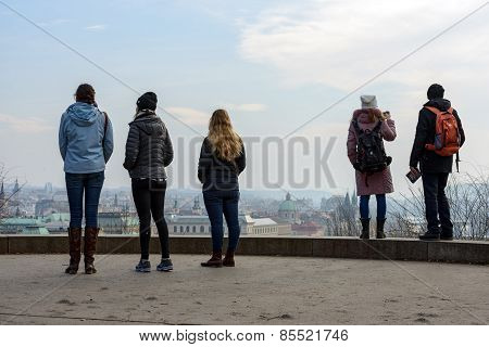 Tourists Are Viewing The Town Panorama In Letna Park, Prague.