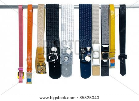 Row of woman many belts on hanger