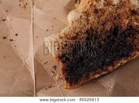 Burnt Bread Crumbs On A Cardboard Background