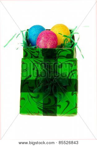 Easter eggs in a colorful Green box nest, isolated on white