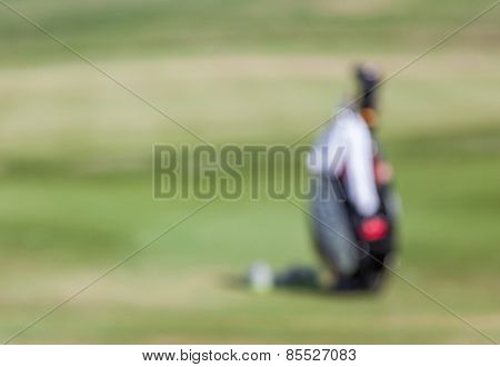 Blurred Photo Of Golf Bag Over The Green Field Background In Golf Tournament.