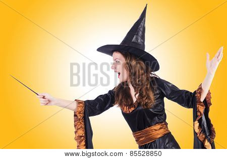 Witch with wand isolated on the white