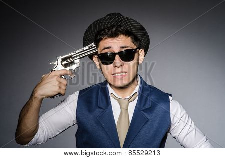 Man wearing sunglasses with gun