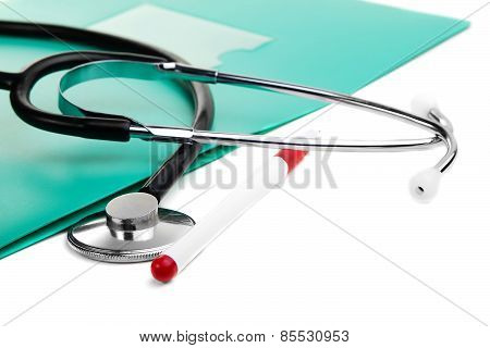 Stethoscope, Pen And Green Folder For Documents