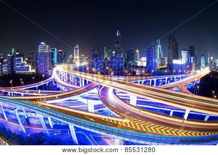illuminated traffic on elevated expressway in modern city