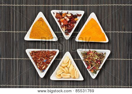 Assortment Of Spices Over A Bamboo Mat