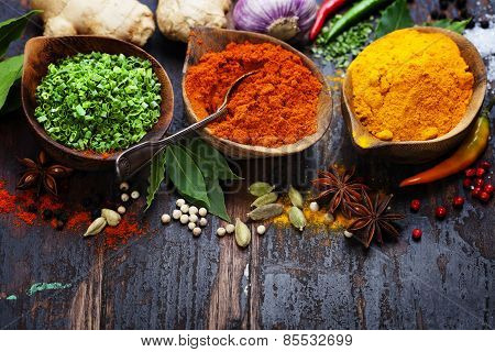 Spices Curry, Paprika, Dry Chives. Spices And Herbs Over Wood