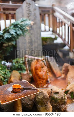 Water dipper at outdoor public hot spring spa area at Shibu Onsen, Nagano Japan