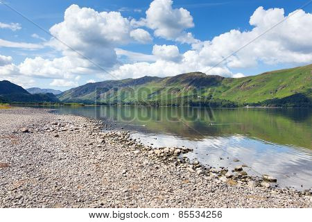 Peaceful calm relaxed summer morning in the English lake District at Derwent Water view to Catbells