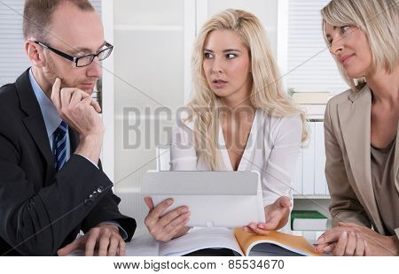 Business team of man and woman analyzing costs and finance.
