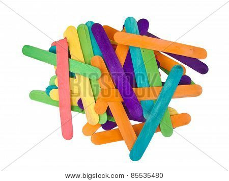 Bunch of colourful popsicle sticks for arts and crafts on a white background