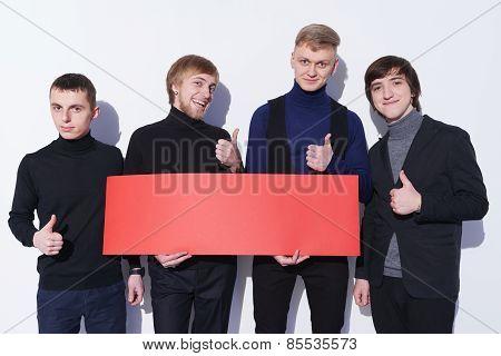 Men holding blank banner