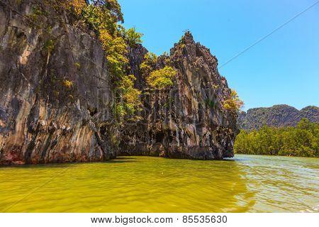 Fantastic island. Island-rock, covered with tropical greenery, among warm Andaman Sea