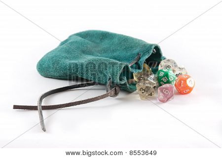 Green Leather Pouch With Many Sided Dice Falling Out On Isolated Background.