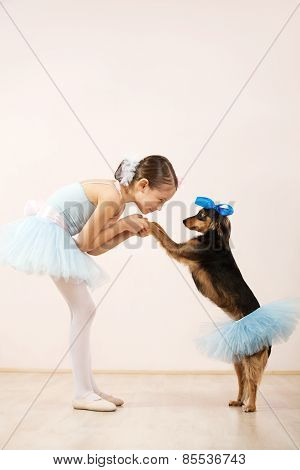 Little Ballerina Dancing With Her Dog