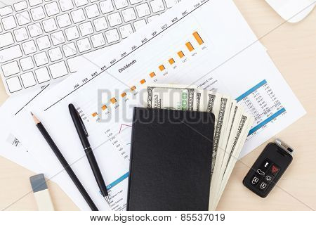 Office table with pc, supplies and money cash. View from above