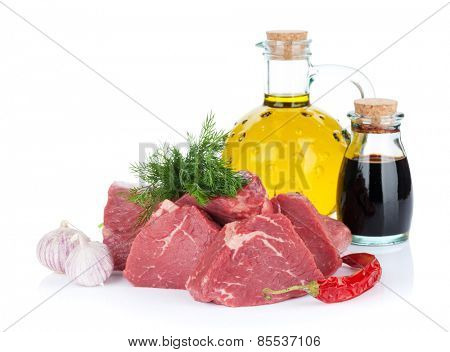 Fillet steak beef meat with spices and condiments. Isolated on white background