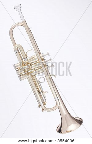 Gold Trumpet Isolated Against White