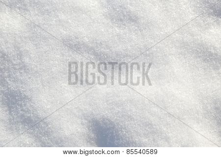 Shiny white soft snow closeup texture