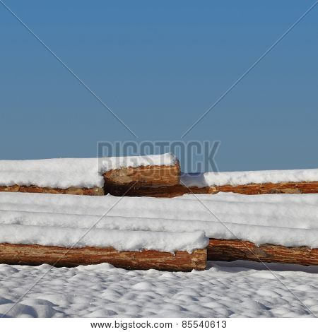Timber stacks on snow