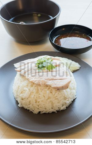 Thai food steamed chicken with rice , Khao mun kai in wood background