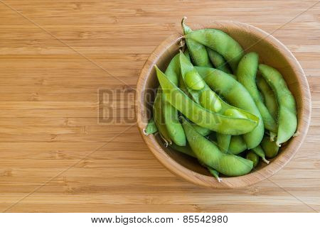 Japanese green soybeans on the wooden table.