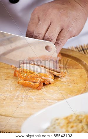 Chef Chopping Roast Chicken For Cooking Noodle