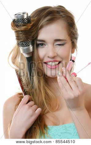 Smile happy girl with make up accessories, studio isolated