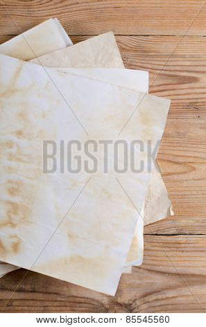 The old paper on a wooden surface