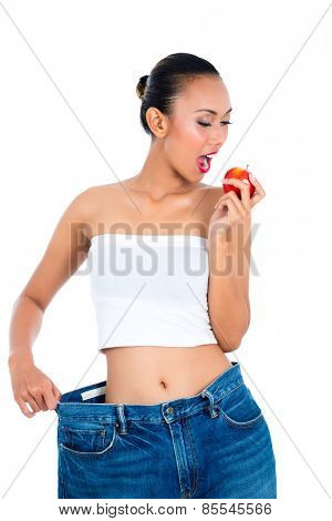 Young Asian woman losing weight by living healthy and eating fruit
