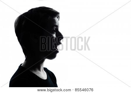 one young teenager silhouette boy or girl portrait in studio cut out isolated on white background