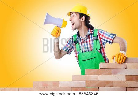 Builder with hard hat on white