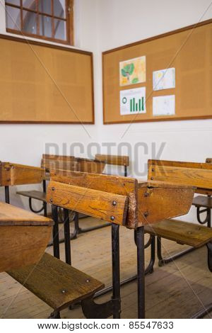 Empty classroom with empty chairs and desks