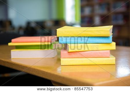 Stack of books in library at the university