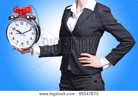 Woman with dynamite and clock on white