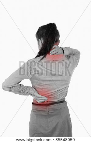 Portrait of the painful back of a businesswoman against a white background
