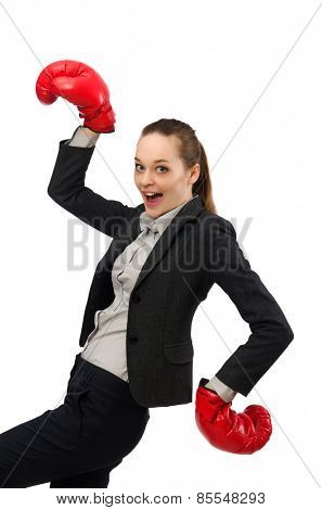 Businesswoman with boxing gloves isolated on white