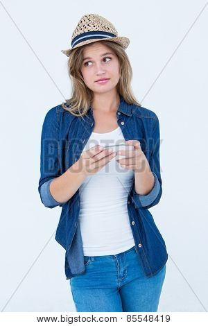 Woman texting with her smartphone on white background