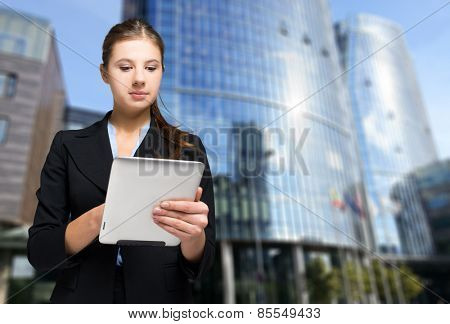 Portrait of a woman using a digital tablet