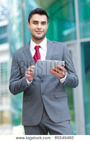 Young business man using his tablet