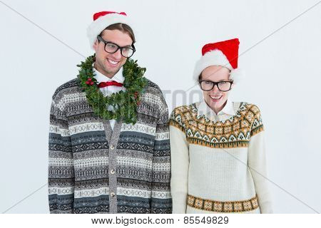 Happy geeky hipster couple looking at camera on white background