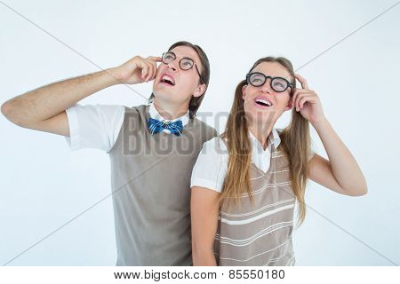 Geeky hipsters looking confused on white background