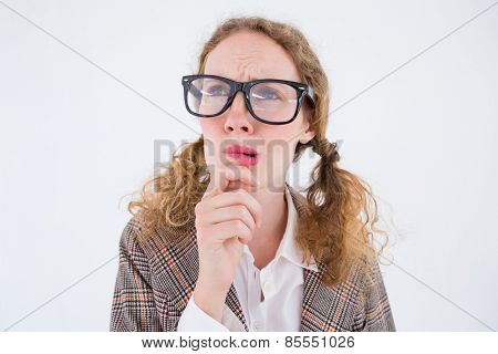 Geeky hipster woman thinking with hand on chin on white background
