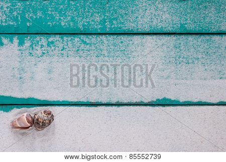 Blank wood sign with sand and seashells