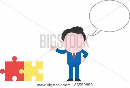 Businessman Beside Puzzle Pieces