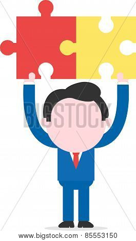 Businessman Holding Puzzle Pieces