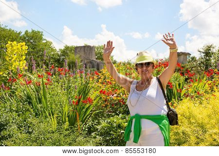 Trendy Joyful Grandma Outdoors In Her Garden