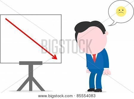 Sad Businessman Beside Chart With Arrow Going Down