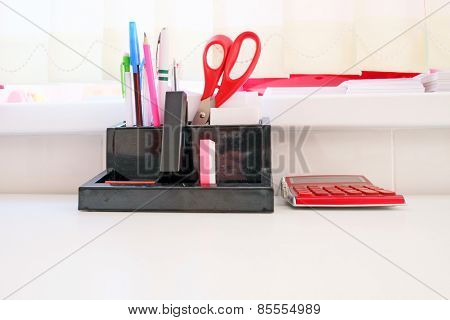 Office supplies including a calculator, stapler, scissors